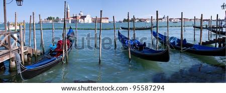 Gondolas lining Piazza San Marco in Venice - stock photo