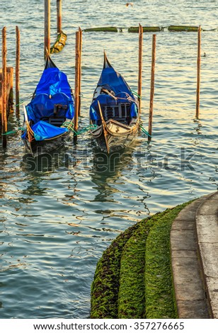 Gondolas moored by Saint Mark square with San Giorgio di Maggiore church in the background - Venice, Venezia, Italy, Europe - stock photo