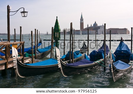 Gondolas moored by Saint Mark square with San Giorgio di Maggiore church in the background - Venice, Venezia, Italy, Europe - stock photo