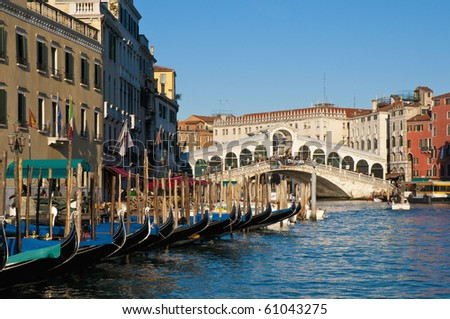Gondolas near Rialto bridge, the oldest of the four bridges crossing the Grand Canal - stock photo