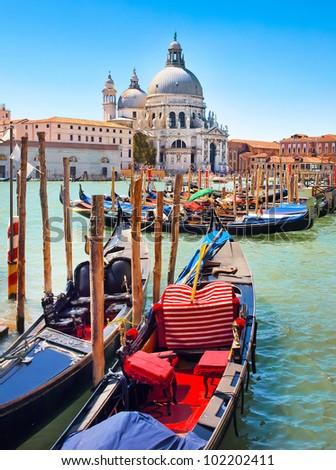 Gondolas on Canal Grande with Basilica di Santa Maria della Salute in the background in Venice, Italy - stock photo