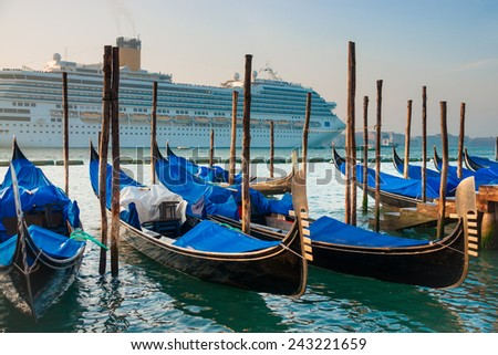 Gondolas on the background of a huge cruise ship, Venice, Venezia, Italy, Europe, - stock photo