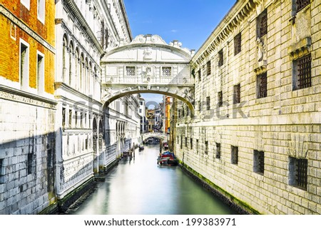 Gondolas passing under the Bridge of Sighs - Ponte dei Sospiri. A legend says that lovers will be granted eternal love if they kiss on a gondola at sunset under the Bridge. Venice, Italy, Europe.