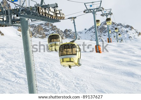 Gondolas rising up la saulire slope in Meribel ski resort, Trois Vallees, France - stock photo