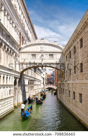 Gondolas under the Bridge of Sighs, a romantic tradition in Venice, Italy