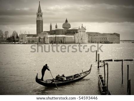 Gondolier in front of San Giorgio Maggiore, Venice - stock photo