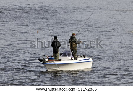 Gone fishing from a boat - stock photo