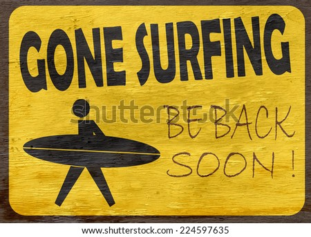 gone surfing sign on wood grain texture - stock photo
