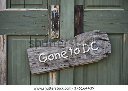 Gone to Washington DC sign on old green doors. - stock photo