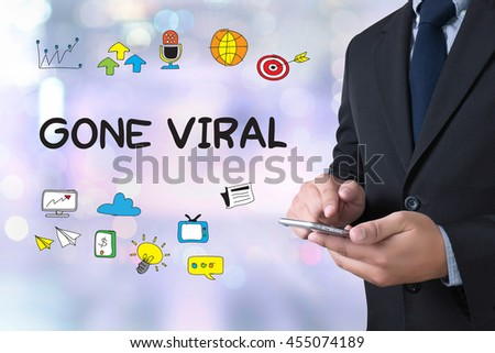 GONE VIRAL businessman working use smartphone on blurred abstract background - stock photo