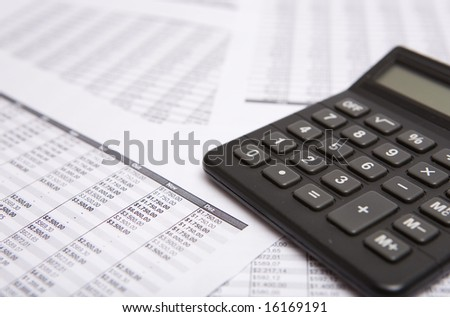 good black calculate, on the financial sheet - stock photo