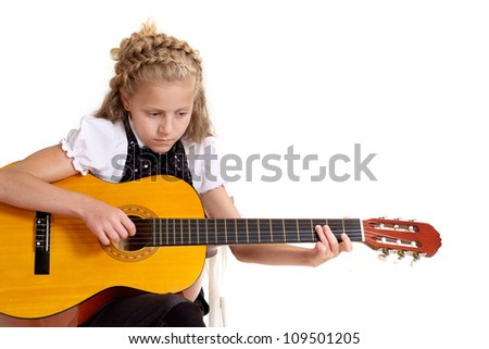 Good child in the school of music on a white background