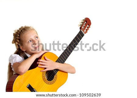 Good child in the school of music on a white background - stock photo