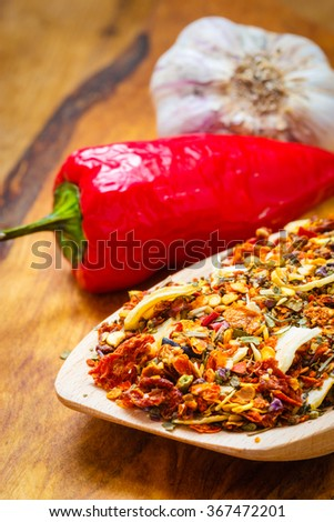 Good cuisine. Closeup colored spices for pasta mix cooking ingredients on wooden spoon - stock photo