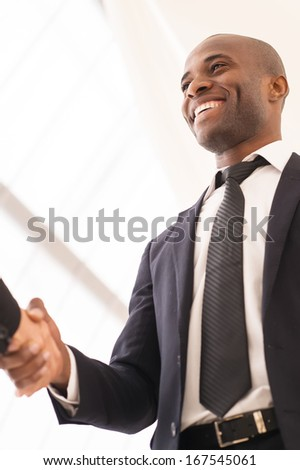 Good deal. Close-up of low angle view of business men shaking hands - stock photo
