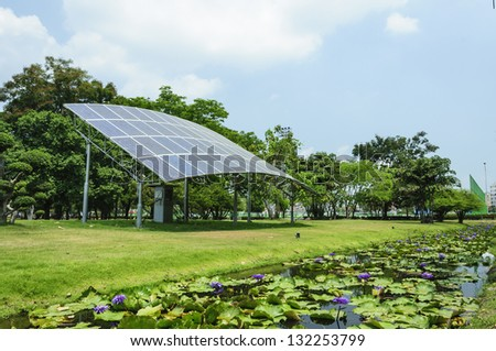 good environment by solar energy panels and blue sky - stock photo