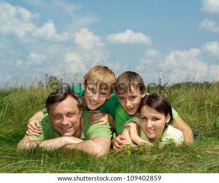 Good family having fun in the company of each other on the nature