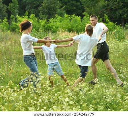 Good family having fun in the company of each other on the nature - stock photo