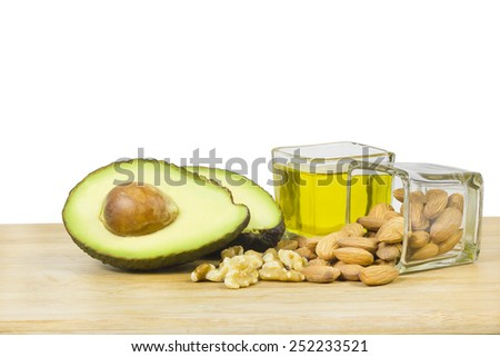 Good fats diet (avocado, dry fruits and oil) - stock photo