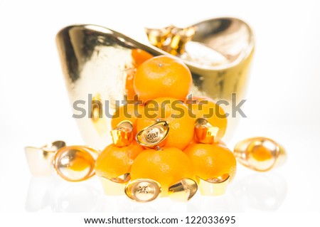 Good fortune with  a stack of plump tangerines and large ingot for Chinese New Year festival - stock photo