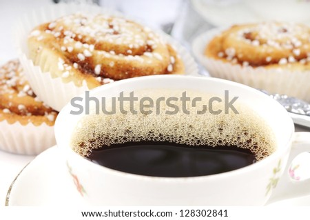 Good freshly baked cinnamon buns and a cup of coffee - stock photo