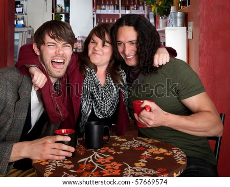 Good friends hanging out at a cafe - stock photo