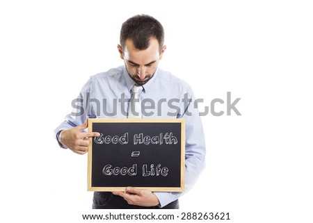 Good health - good life - Young businessman with blackboard - isolated on white - stock photo