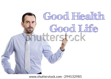 Good health - good life  Young businessman with small beard pointing up in blue shirt - stock photo