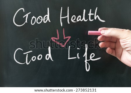Good health to good life conceptional words written on blackboard using chalk - stock photo