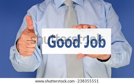 Good Job - Businessman with sign and thumb up - stock photo