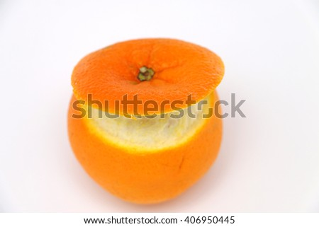 good juicy orange peel cut out on a white background