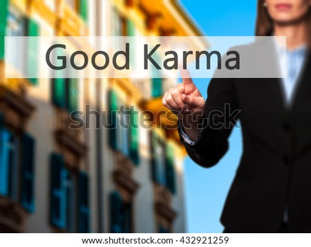 Good Karma - Businesswoman hand pressing button on touch screen interface. Business, technology, internet concept. Stock Photo - stock photo