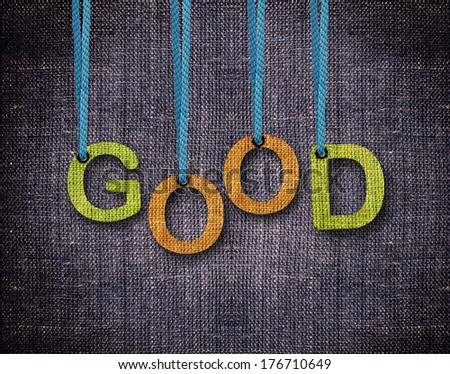 Good Letters hanging strings with blue sackcloth background. - stock photo