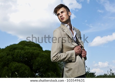 Good looking beautiful young man outdoor - stock photo