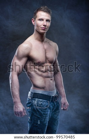 Good looking bodybuilder posing - stock photo