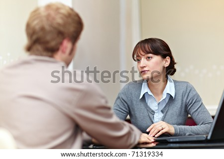 Good looking boss talking to her employee