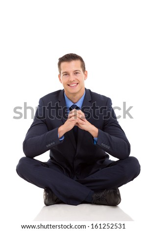 good looking businessman relaxing on floor isolated on white - stock photo