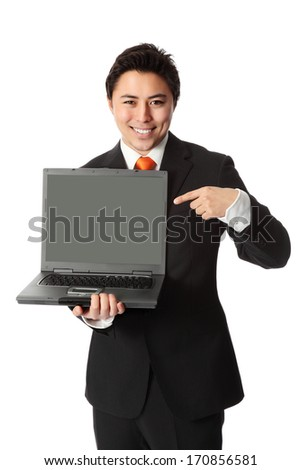 Good looking businessman with a lap top computer, wearing a suit and tie. White background.