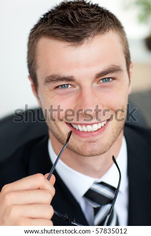 Good-looking businessman with glasses in his office - stock photo