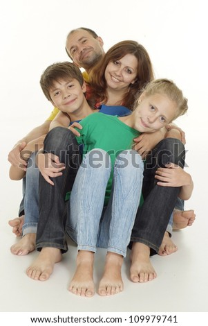 Good-looking family of four in bright T-shirt on a white background - stock photo