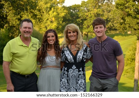 good-looking family with college kids - stock photo