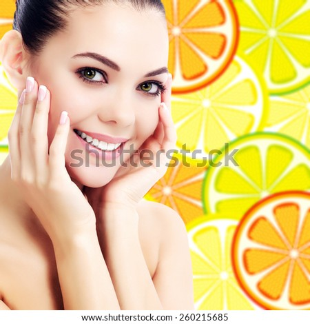 Good looking female on a background with orange slices - stock photo