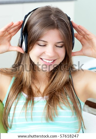 Good-looking girl listening to music at home