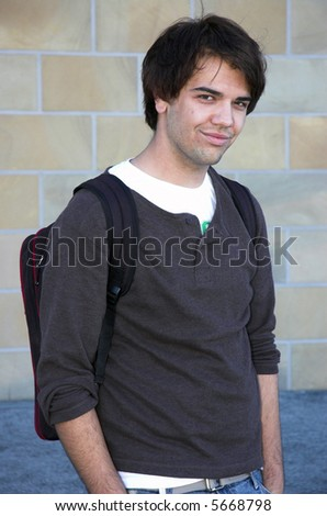 Good looking guy with backpack on his way to College. - stock photo