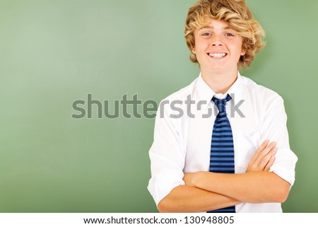 good looking male high school student in classroom - stock photo
