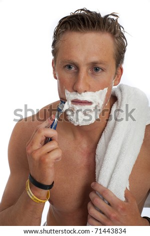 Good looking male isolated ahving a wet shave