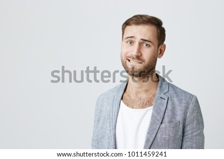 When a man bites his lower lip