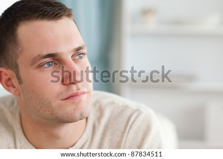 Good looking man posing in his living room - stock photo