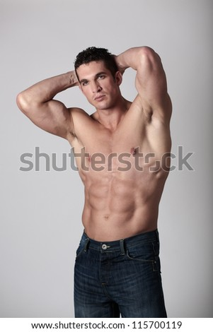 good looking man with his top of showing off his great body - stock photo