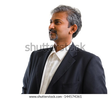 Good looking mature Asian Indian business man with business suit looking at side, isolated on white background. Portrait of handsome Indian male model. - stock photo